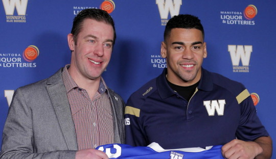 Winnipeg Blue Bomber General Manager Kyle Walters and running back Andrew Harris in the Press Room at Investors Group Field. BORIS MINKEVICH / WINNIPEG FREE PRESS February 12, 2016
